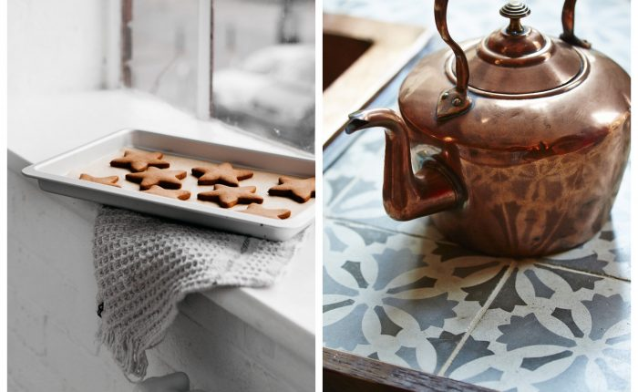 Copper kettle sits on tile worktop next to baked ginger bread stars