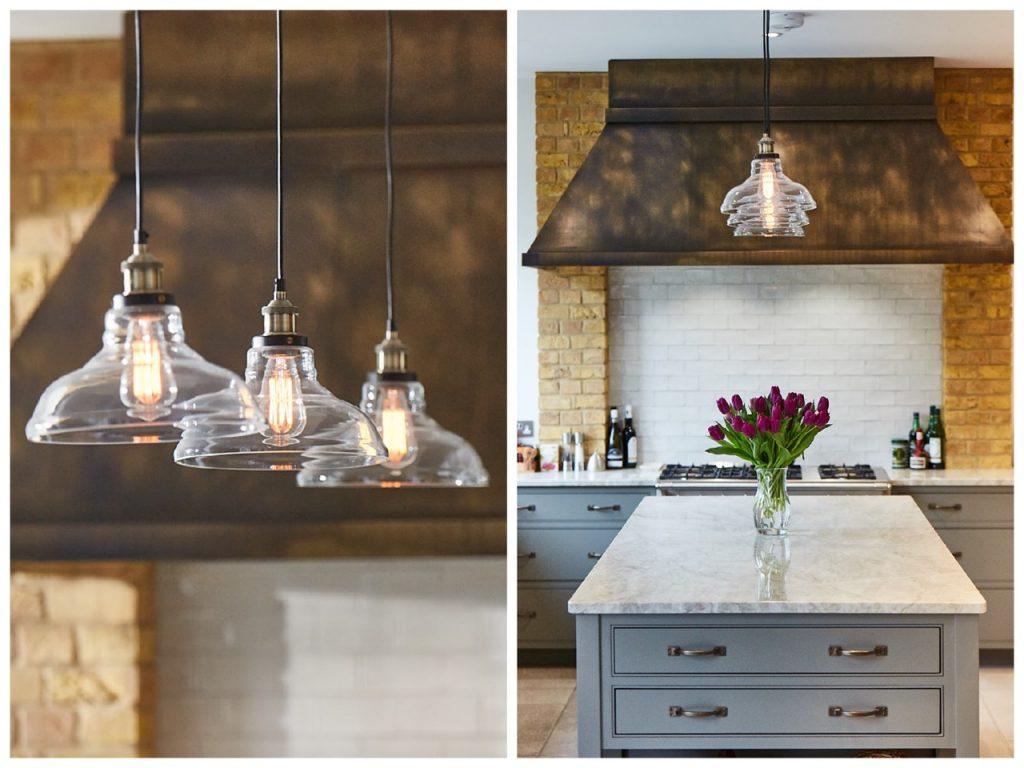 Glass pendant lights above bespoke kitchen island