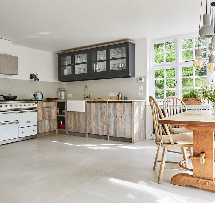 White driftwood bespoke kitchen with white Lacanche range cooker and painted lamp black wall cabinets