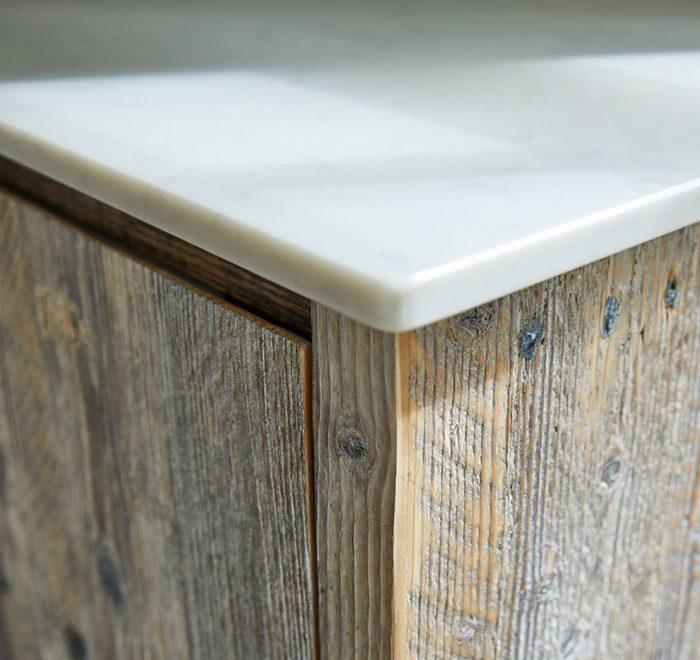 White quartz kitchen worktop on top of reclaimed rustic wood unit