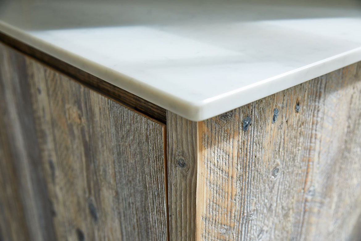 White quartz kitchen worktop on top of reclaimed rustic wood unit