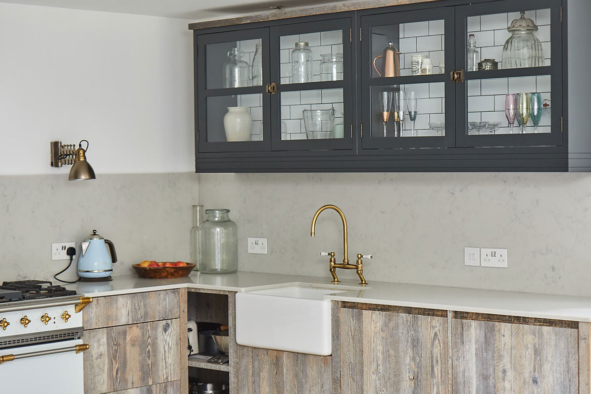 Reclaimed pine kitchen with large white quartz up stands