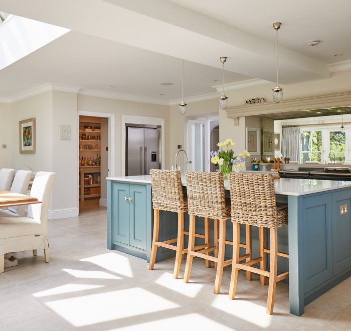 Open plan kitchen with bespoke kitchen island incorporating breakfast bar stools