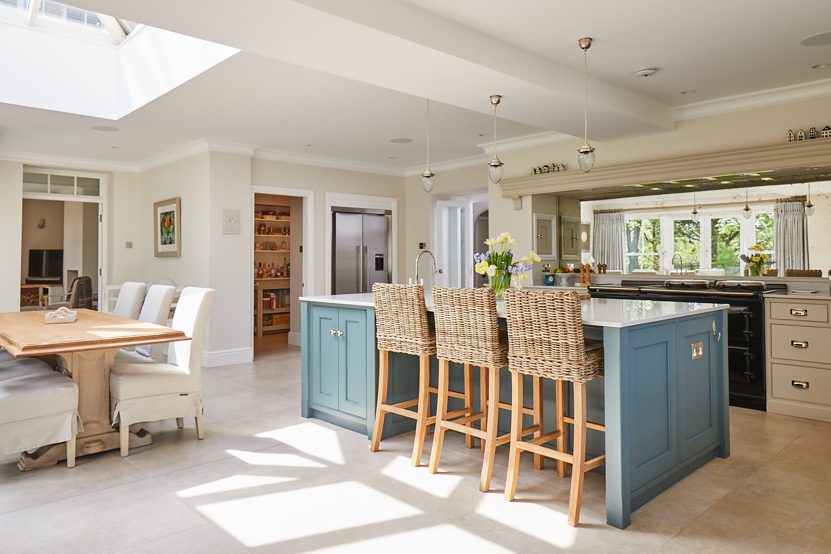 Open plan kitchen with bespoke kitchen island incorporating breakfast bar stools