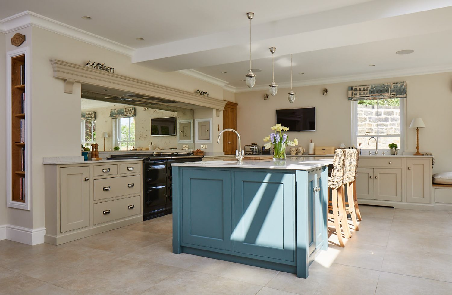 Shadow casts down on green kitchen island with integrated breakfast bar
