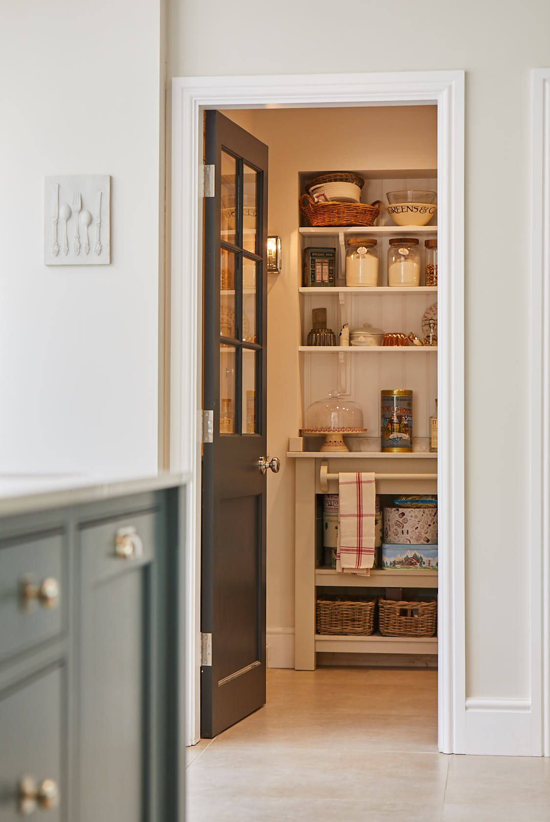 Door leads to bespoke walk in pantry