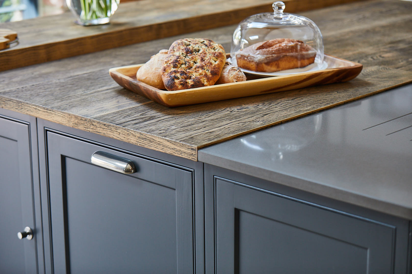 Lamp black shaker cabinets with engineered oak wood worktop and Finesse pewter cup handle