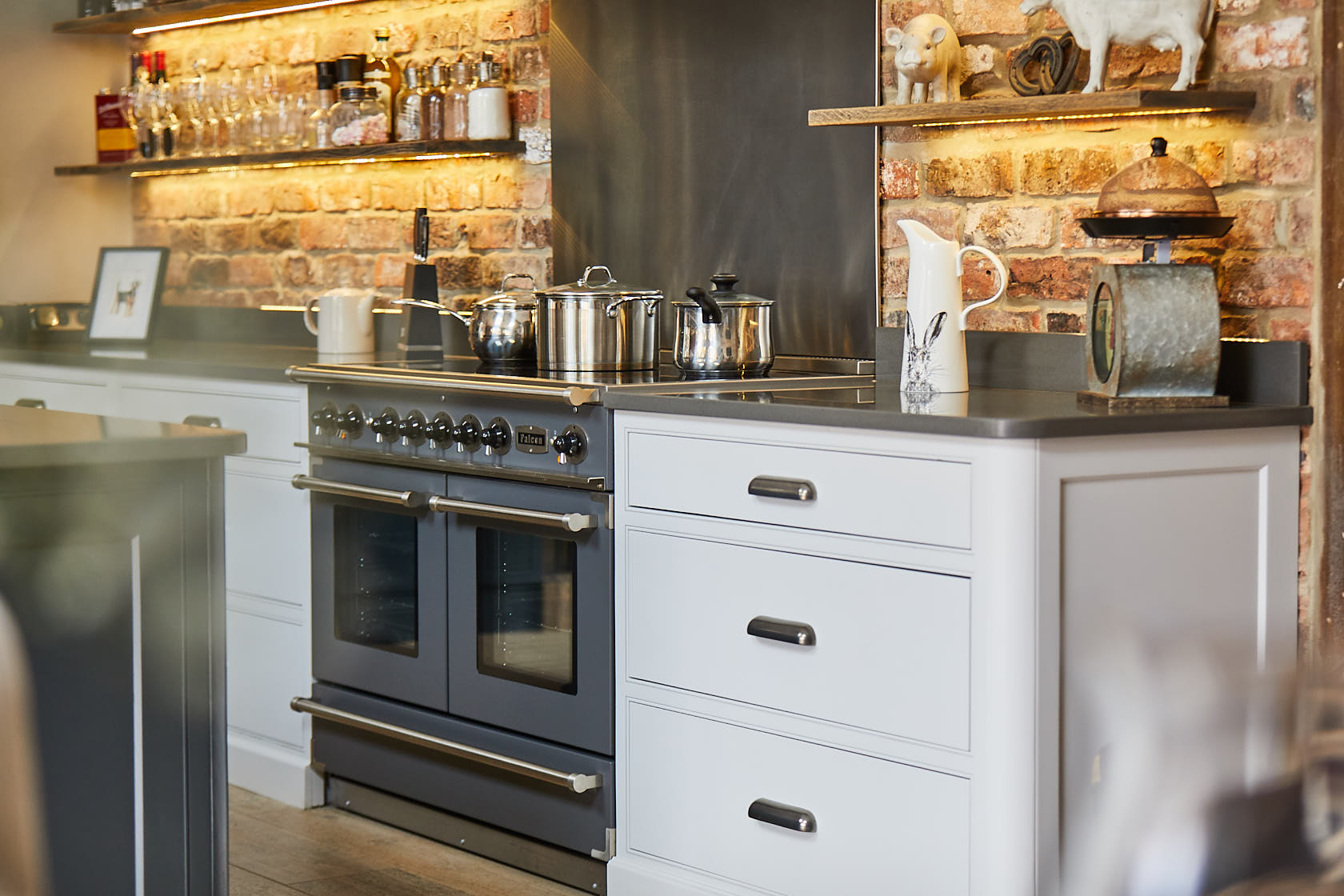 Pan drawers with Finesse pewter cup handles and Caesarstone worktop