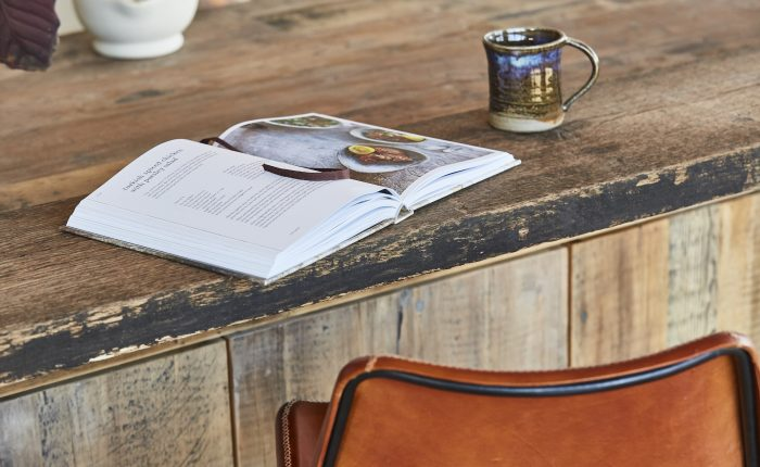 Rustic reclaimed breakfast bar with open book and mug