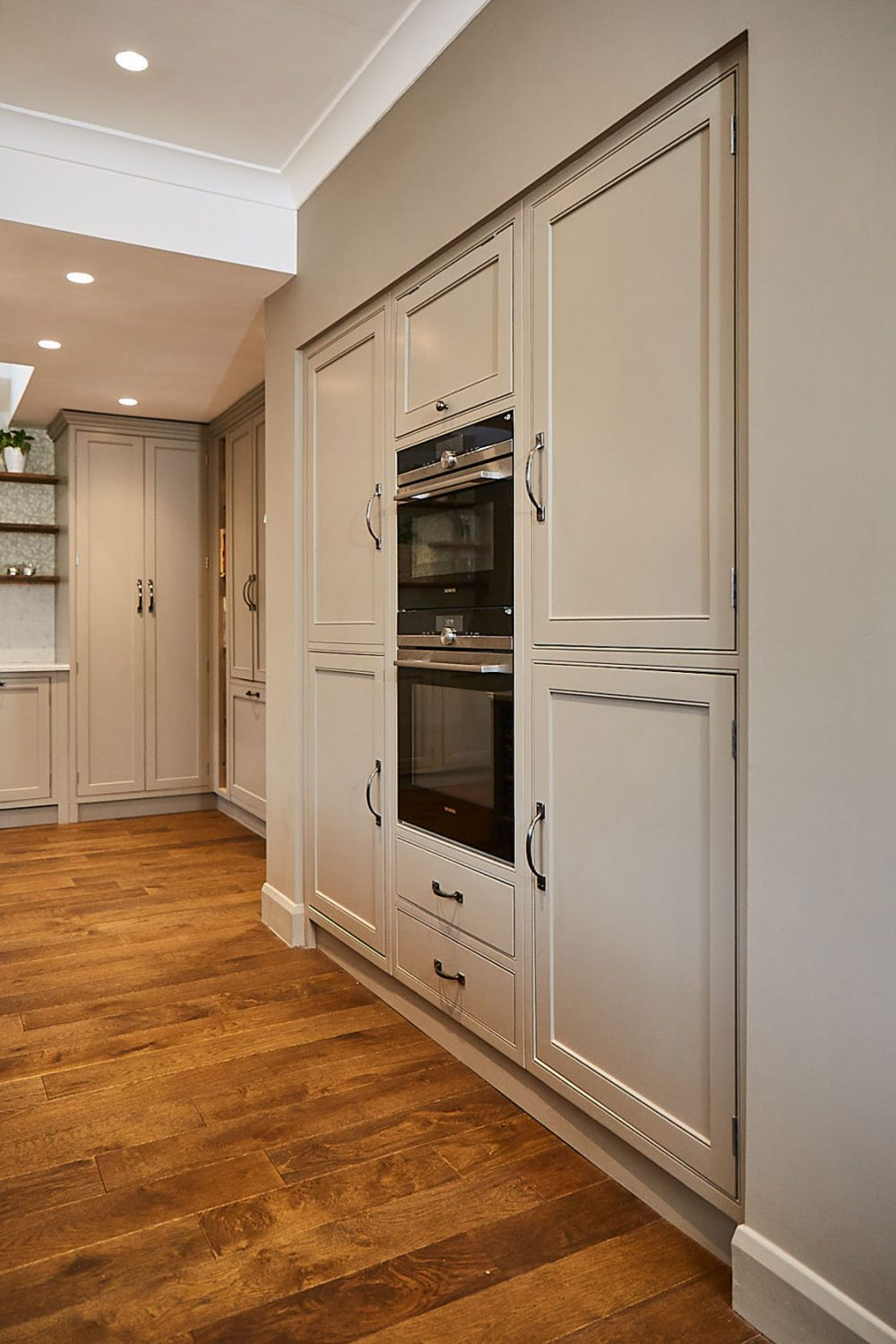 Integrated eye level Siemens oven in traditional painted cabinet