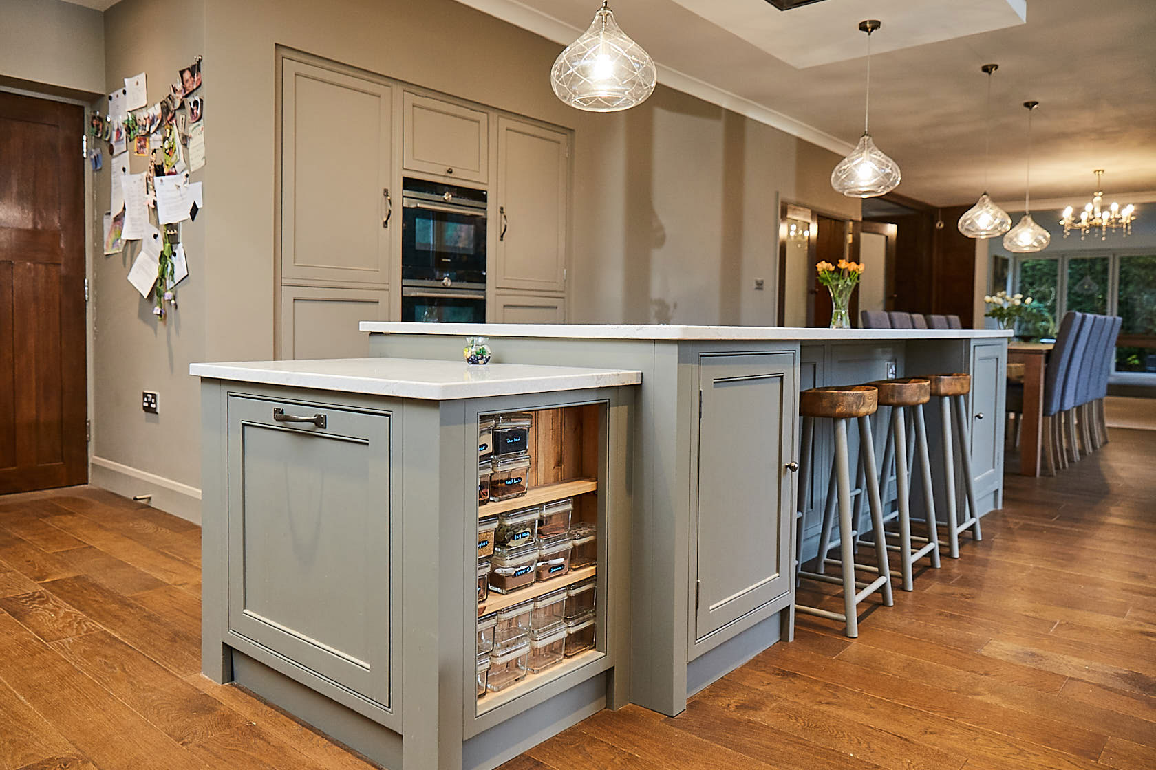 Bespoke kitchen unit with open spice rack on the side