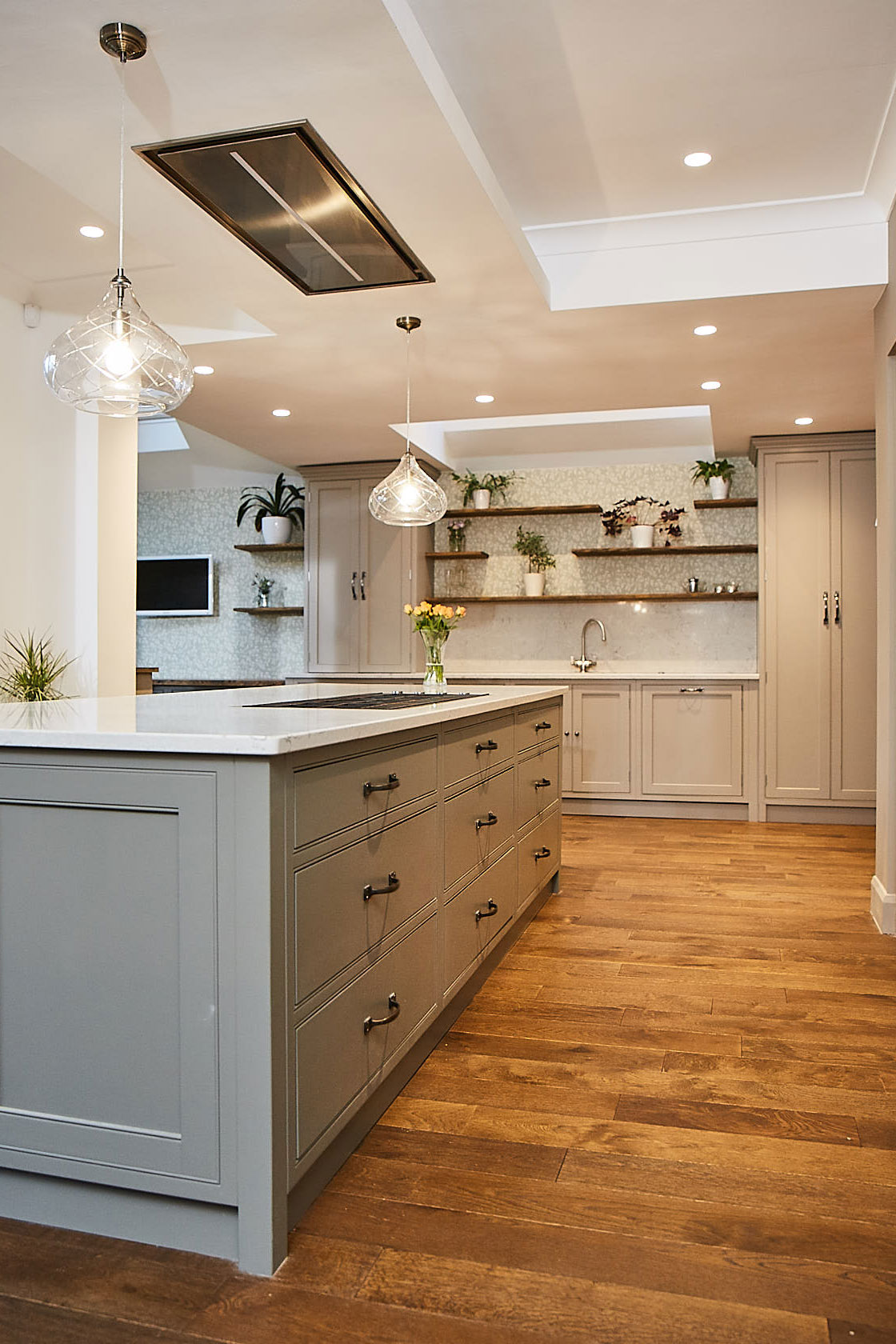 Traditional painted kitchen island with oak floor boards