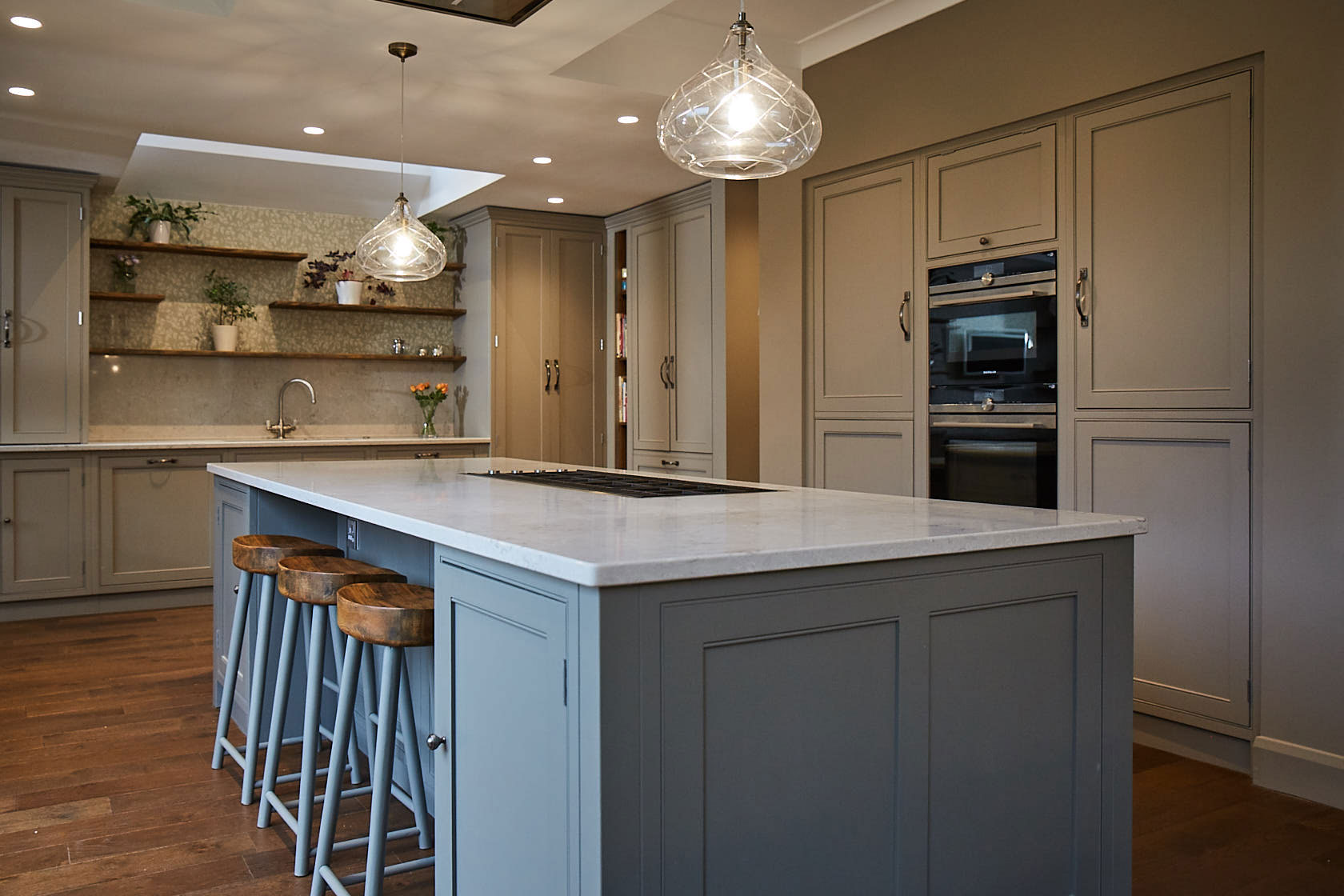 Crystal pendant light over kitchen island with white worktops