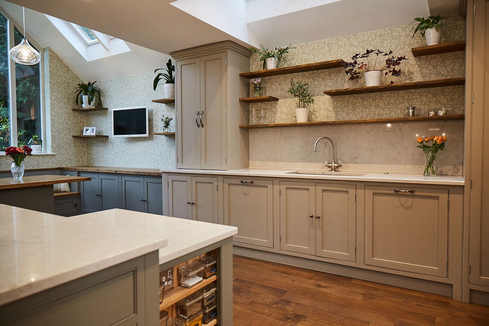Traditional painted bespoke kitchen sink run with oak flooring