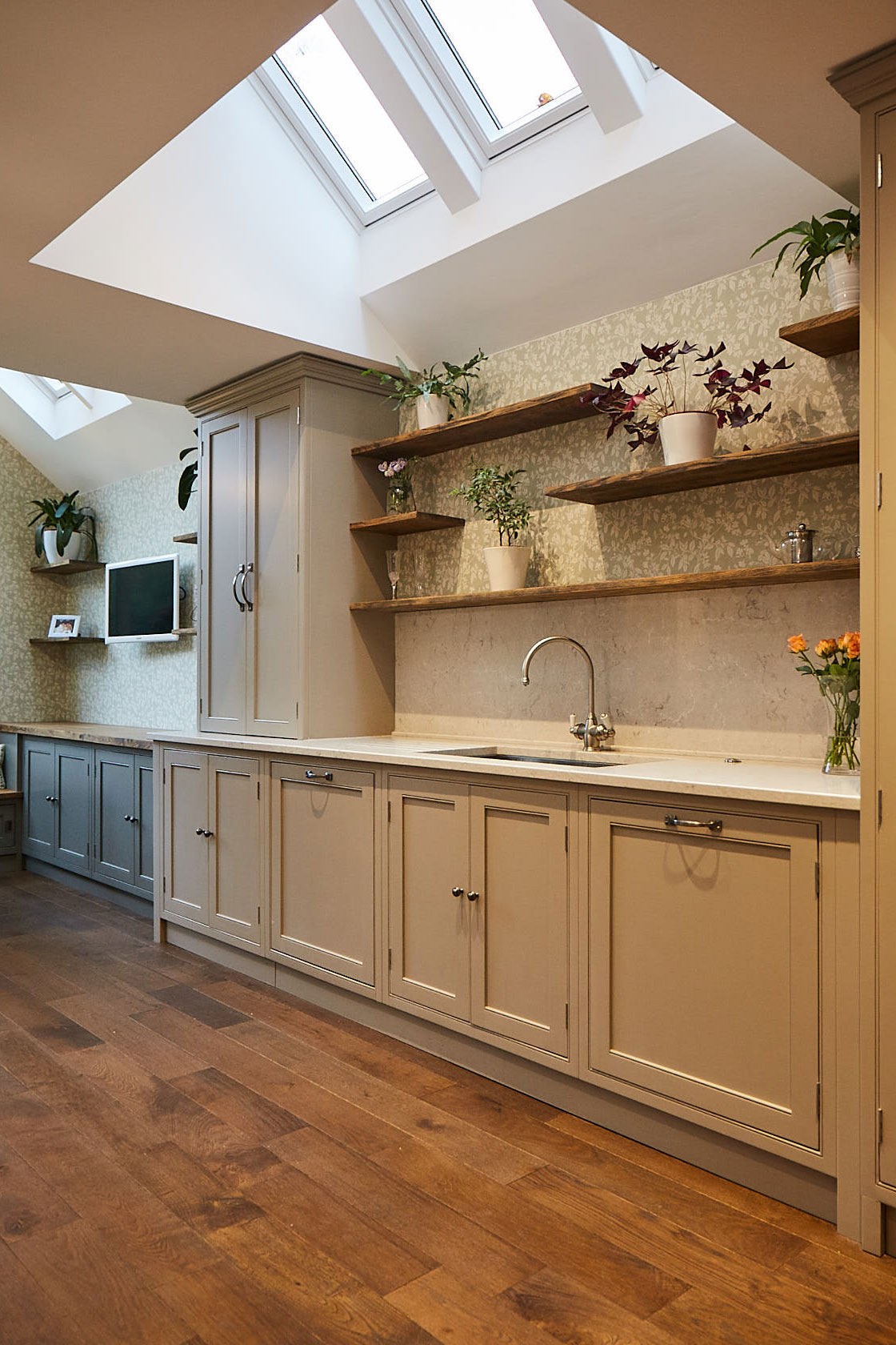 Mixture of painted cabinets and floating oak shelves