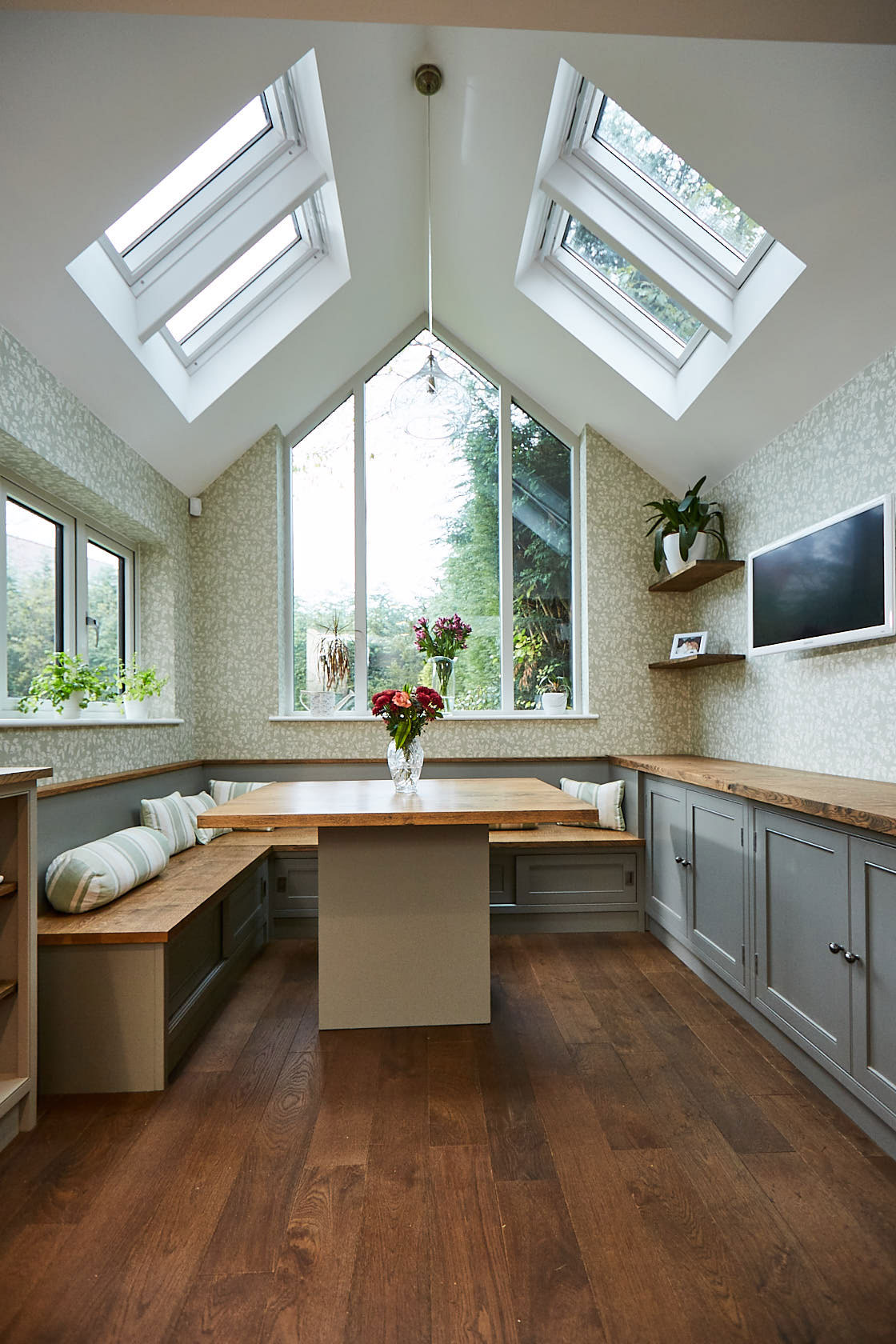 Bespoke kitchen table with fitted booth seating around
