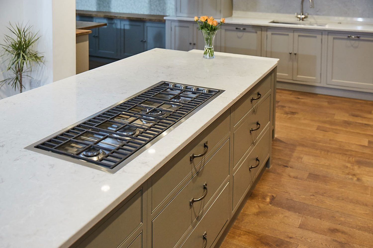 Flush gas hob on kitchen island with hand ages oak floor