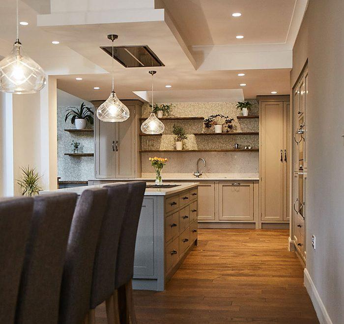 Green grey kitchen with white quartz worktops