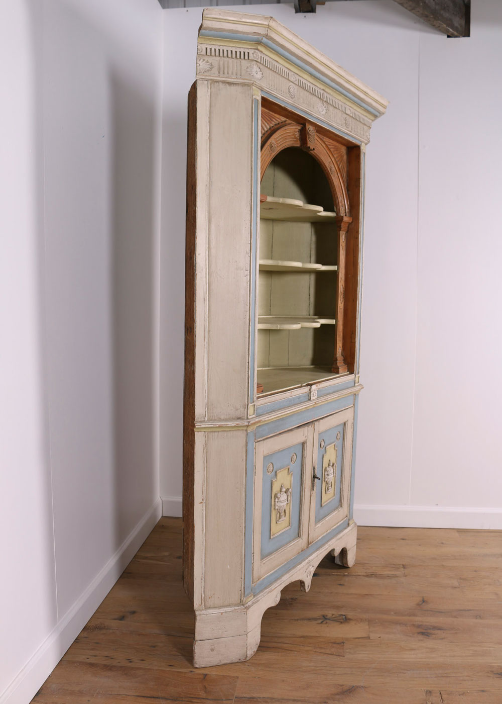 Side view of tall corner cabinet