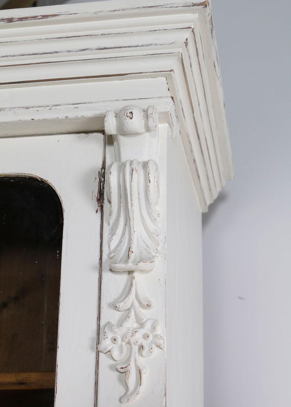 White china cabinet cornice detail