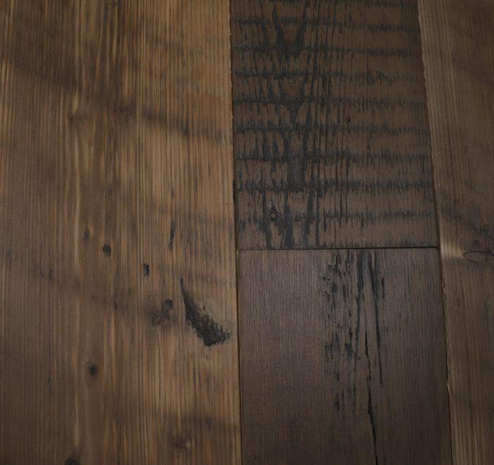 Knot on reclaimed pine floor board