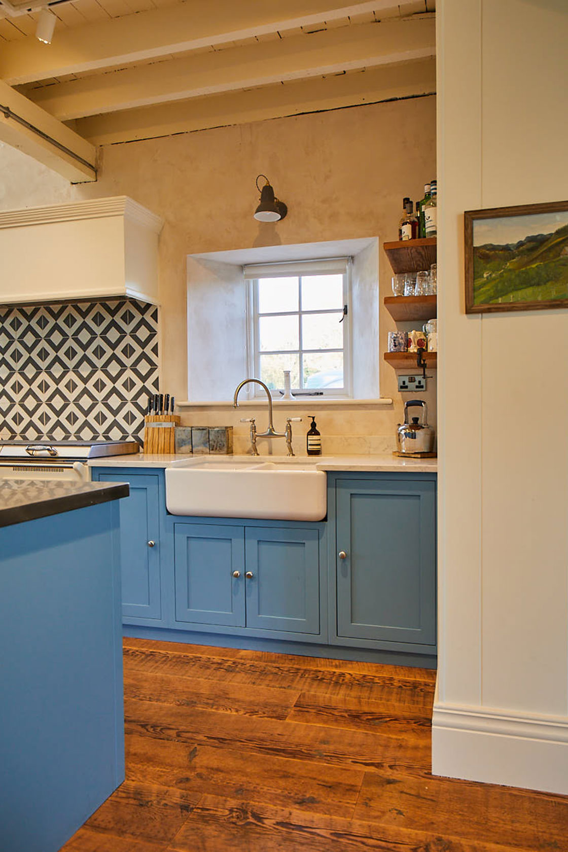 Sink run with stainless steel mixer tap traditional shaker cabinets and ceramic belfast double sink