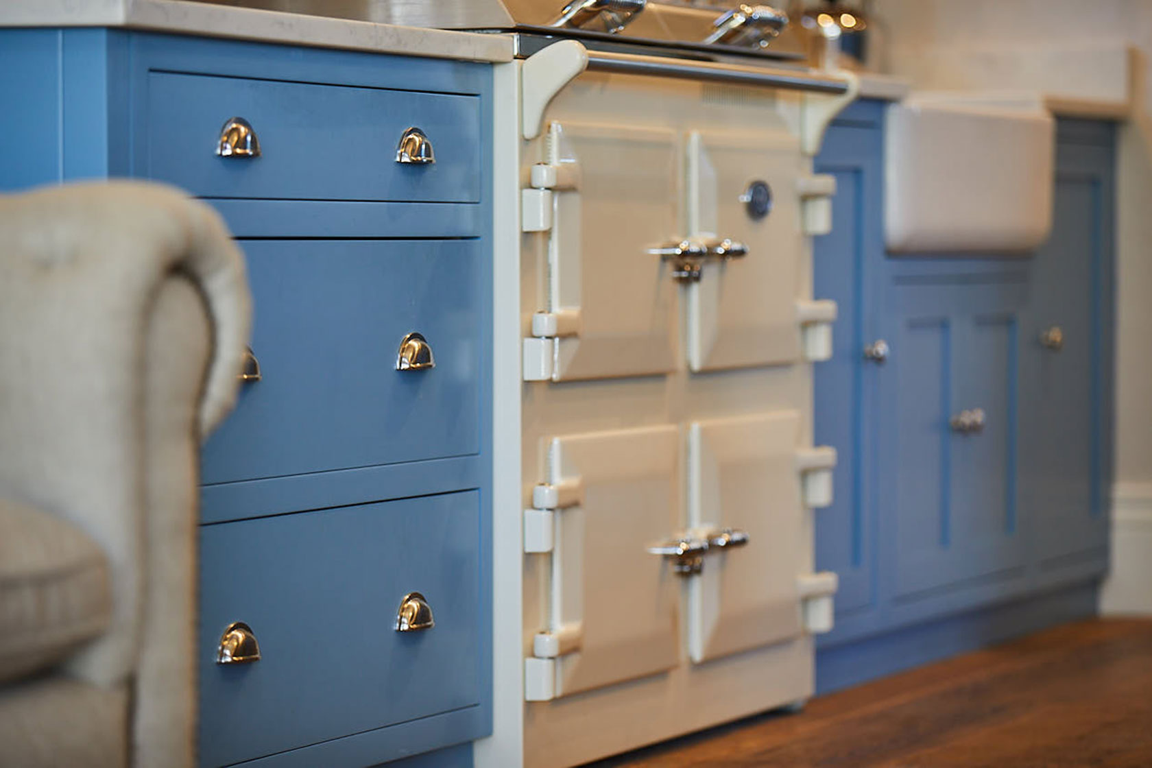 Cream Everhot flush with light blue shaker cabinets