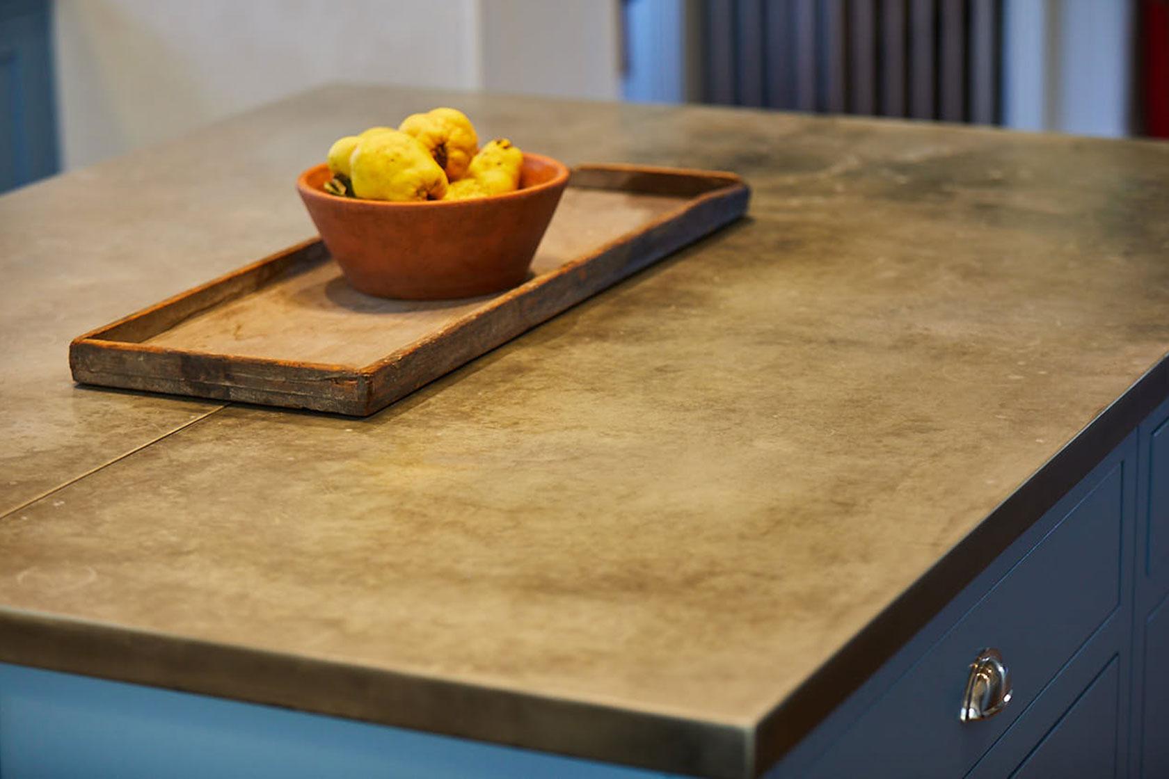 Fresh fruit in bowl on metal zinc worktop