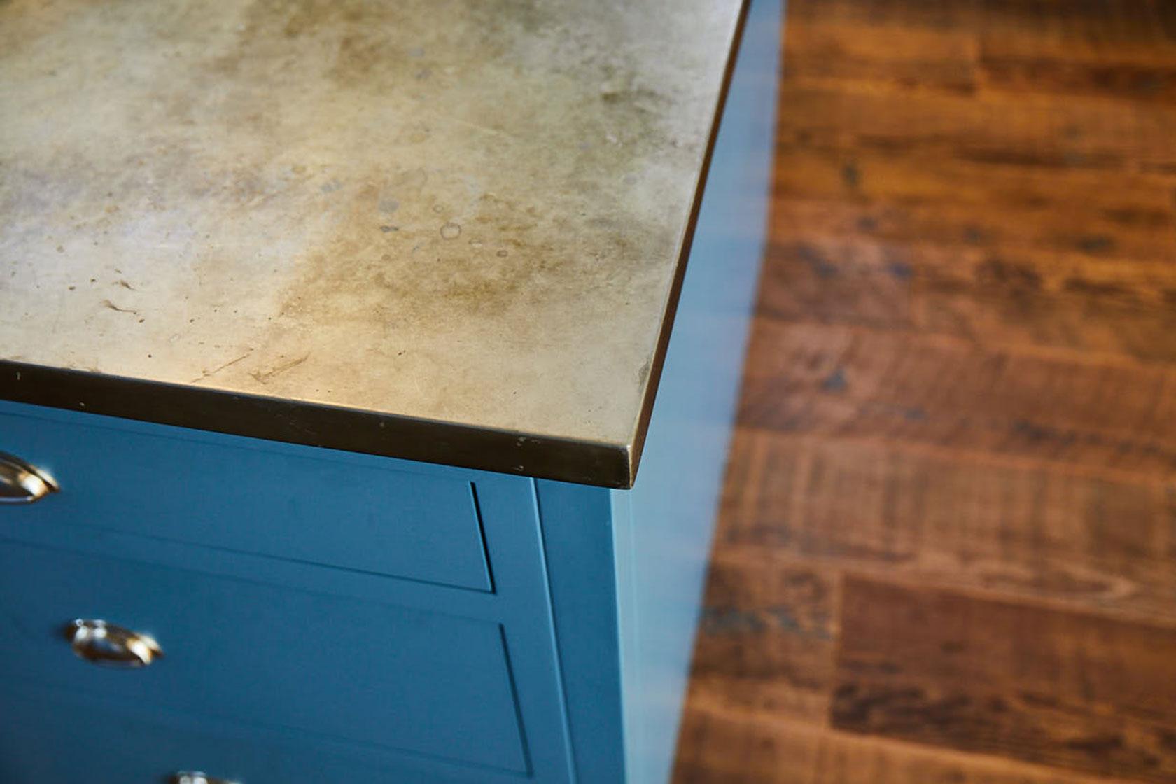 Corner of zinc patina metal worktop