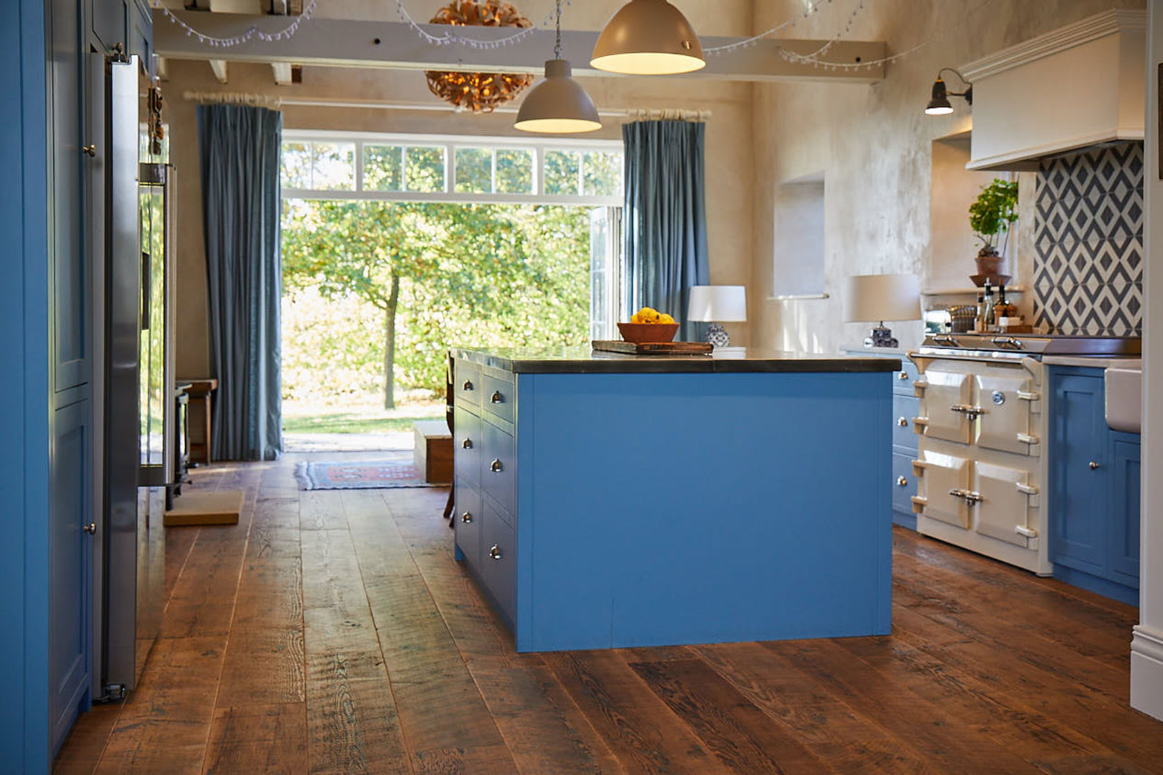 Flat baby blue end panel with pinewood engineered floor boards
