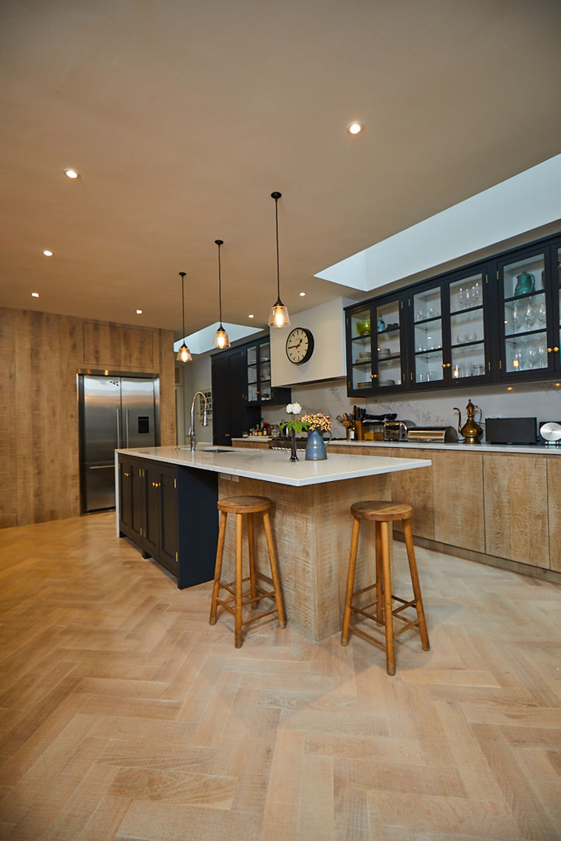 Solid oak barstools sit under kitchen island