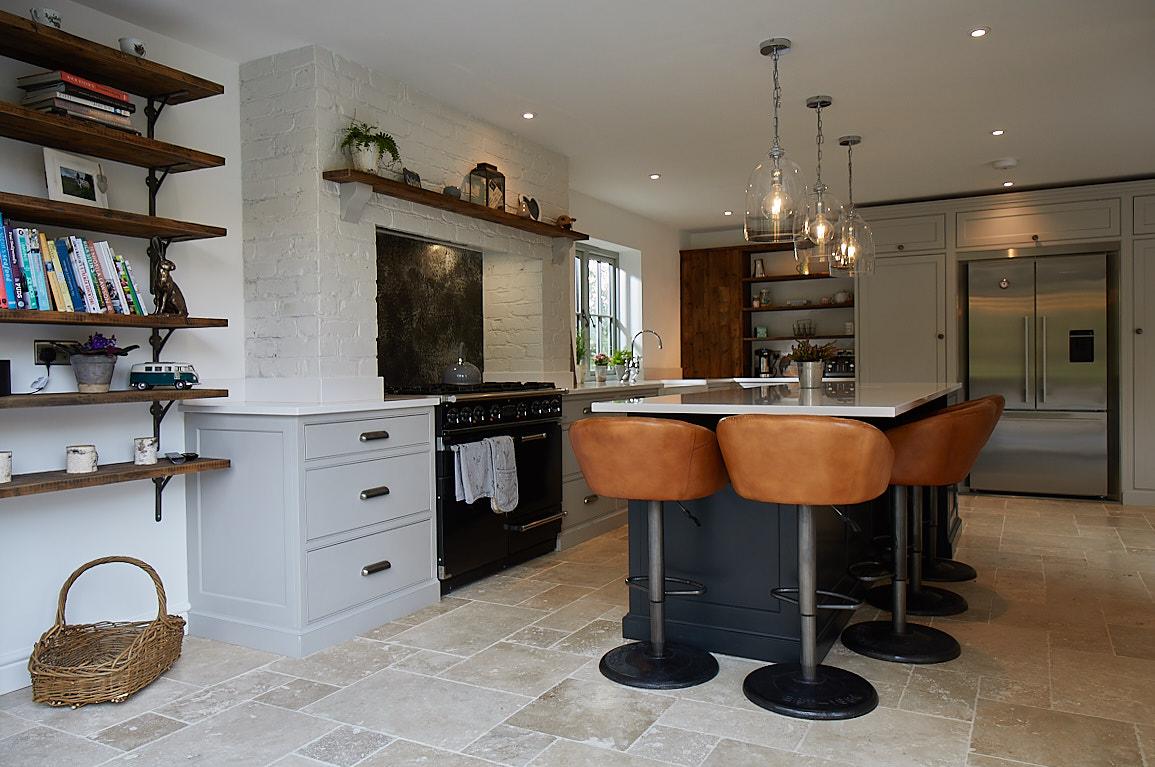 Brown leather bar stool around kitchen island