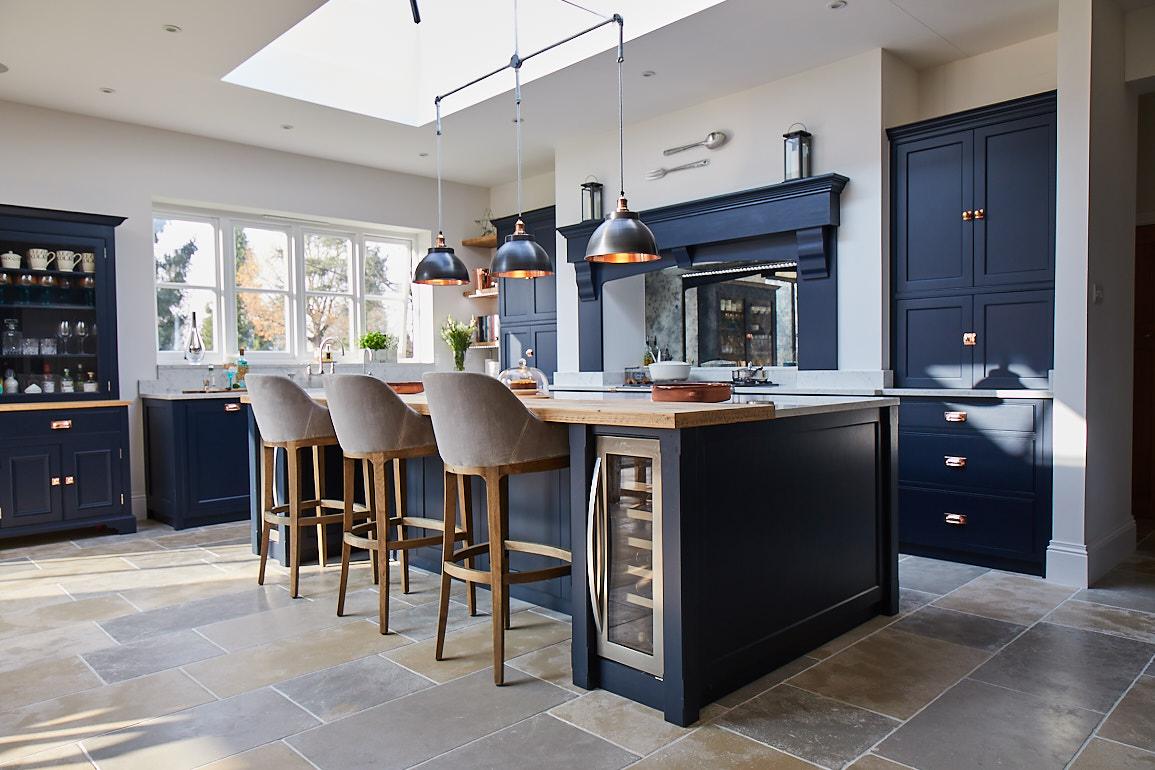 Open plan kitchen with large dark blue bespoke island