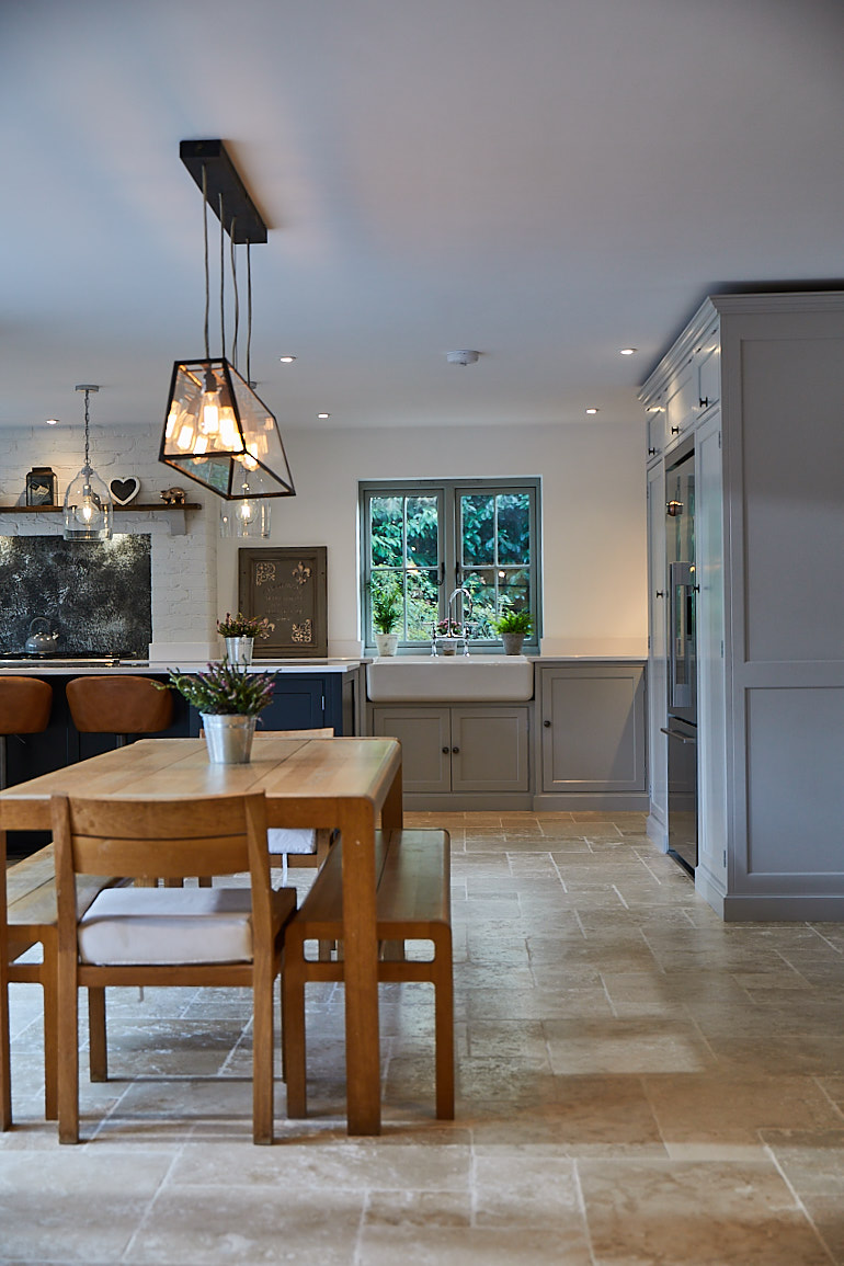 Contemporary oak dining table and bench in open plan kitchen