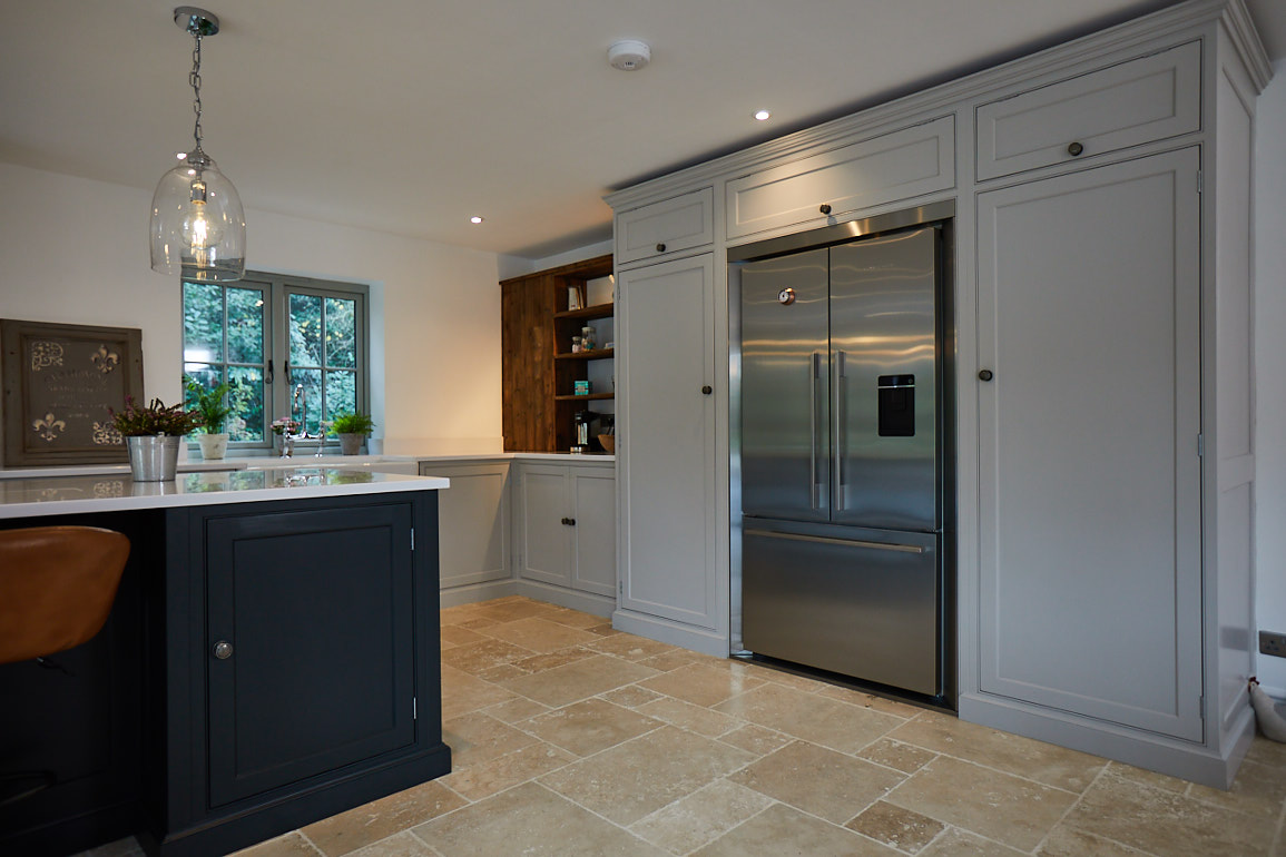 Fisher & Paykel fridge freezer integrated in to tall painted kitchen cabinets