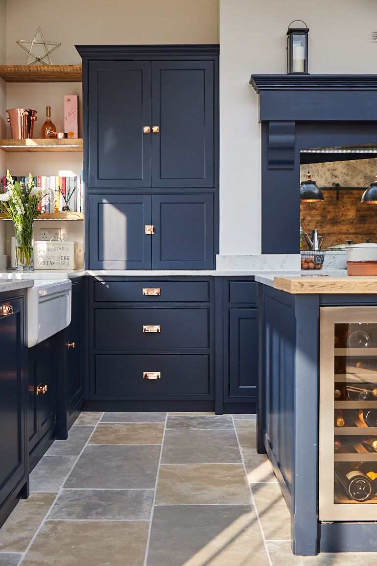 Dark blue pan drawers with copper cup handles