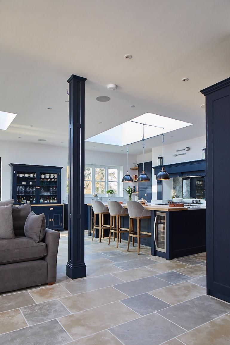 RSJ pillar cladded in dark blue painted panel to match bespoke kitchen
