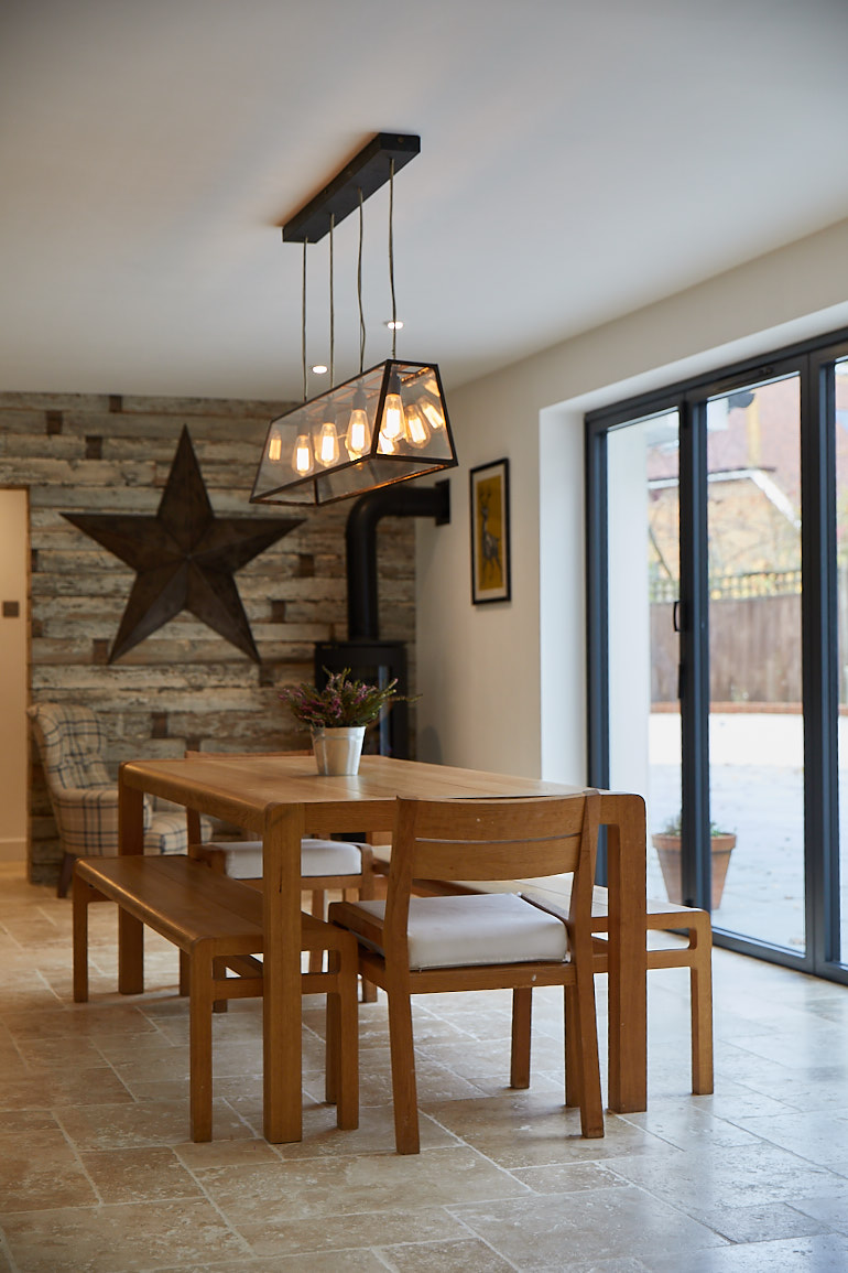 Oak dining table and chairs with pendant light bulbs above