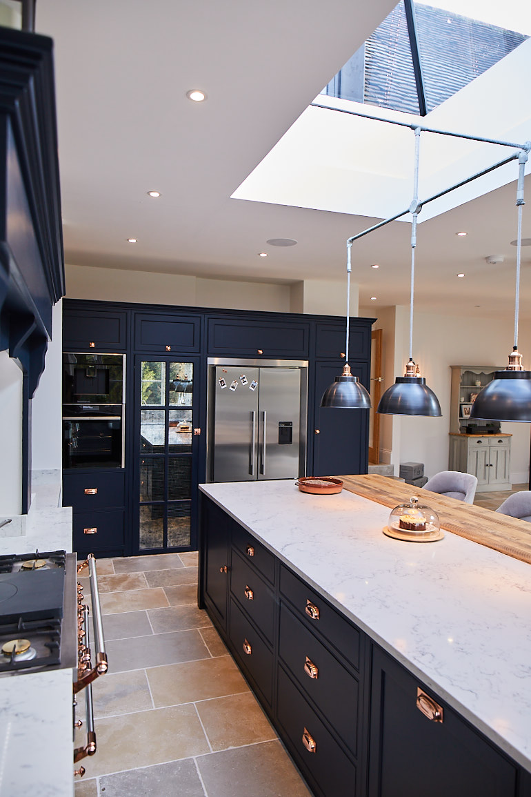 Pan drawers and integrated bin in kitchen island painted in dark blue by Little Greene Paint Company