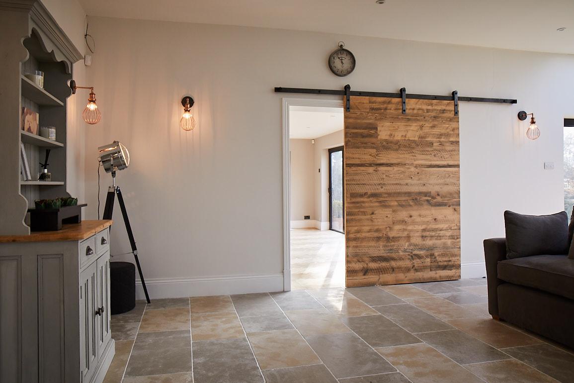 Engineered reclaimed pine door with industrial sliding mechanism