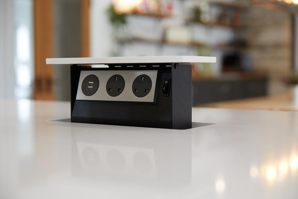 Pop up plug in kitchen island with white quartz worktop