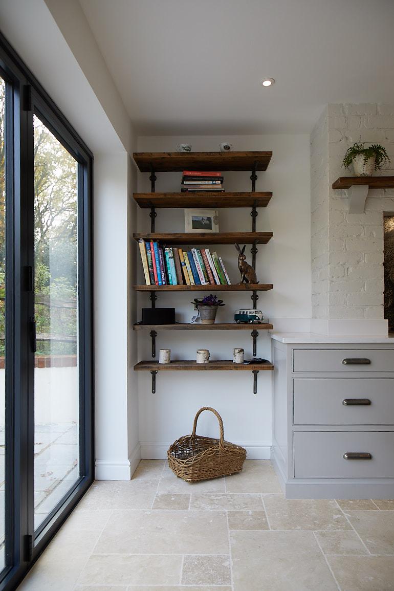 Rustic shelves on cast brackets full of books