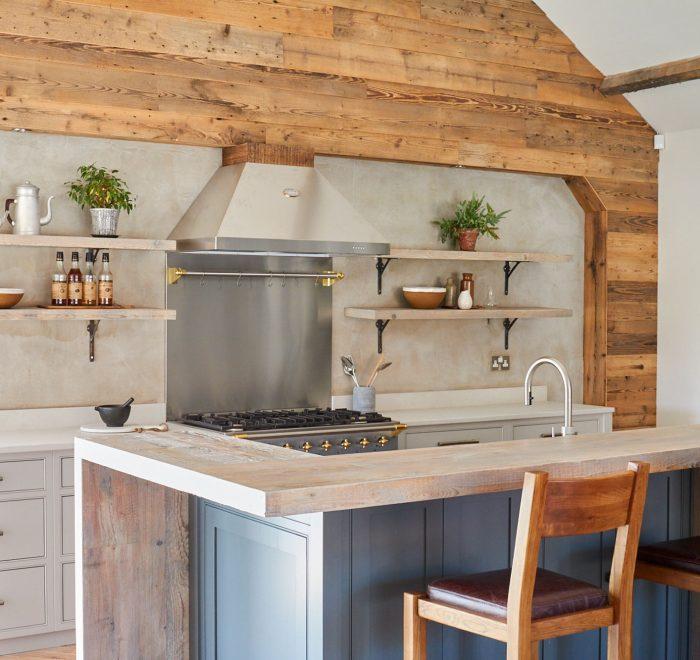 Oak barstools under reclaimed engineered breakfast bar on bespoke kitchen island