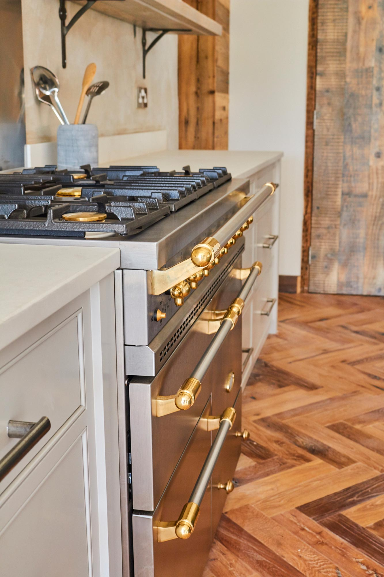 Stainless steel range cooker sits on herringbone oak floor