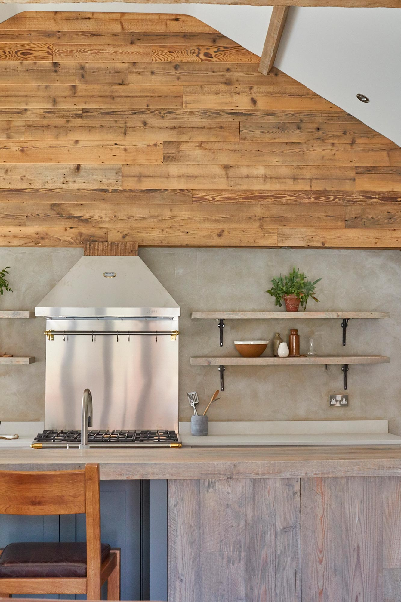 Interior vaulted wall cladded with reclaimed pine timber