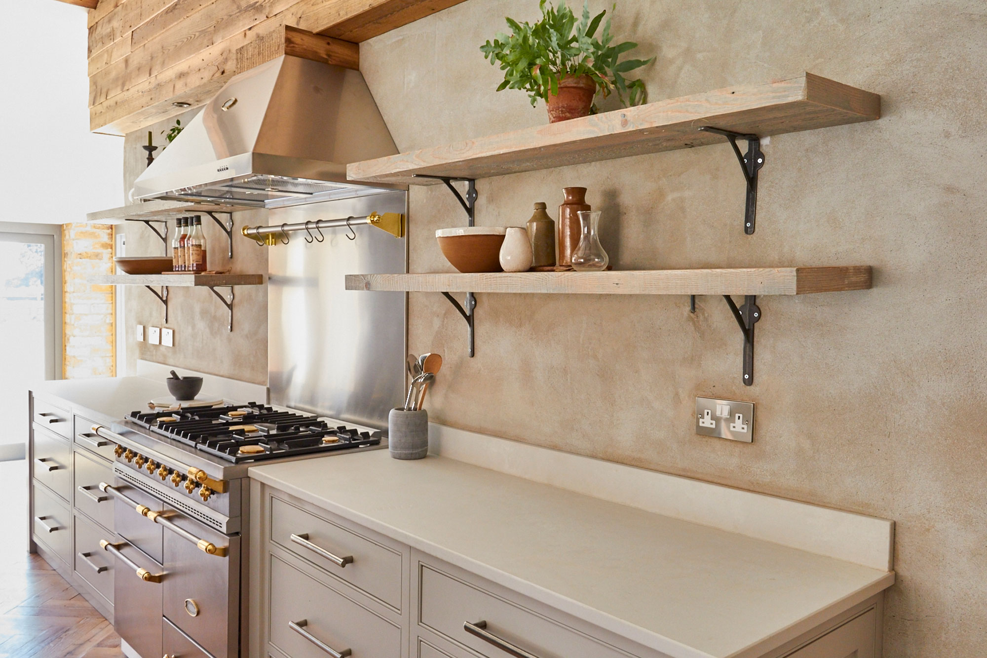Rustic open shelves above Caesarstone white worktop and bespoke kitchen pan drawers