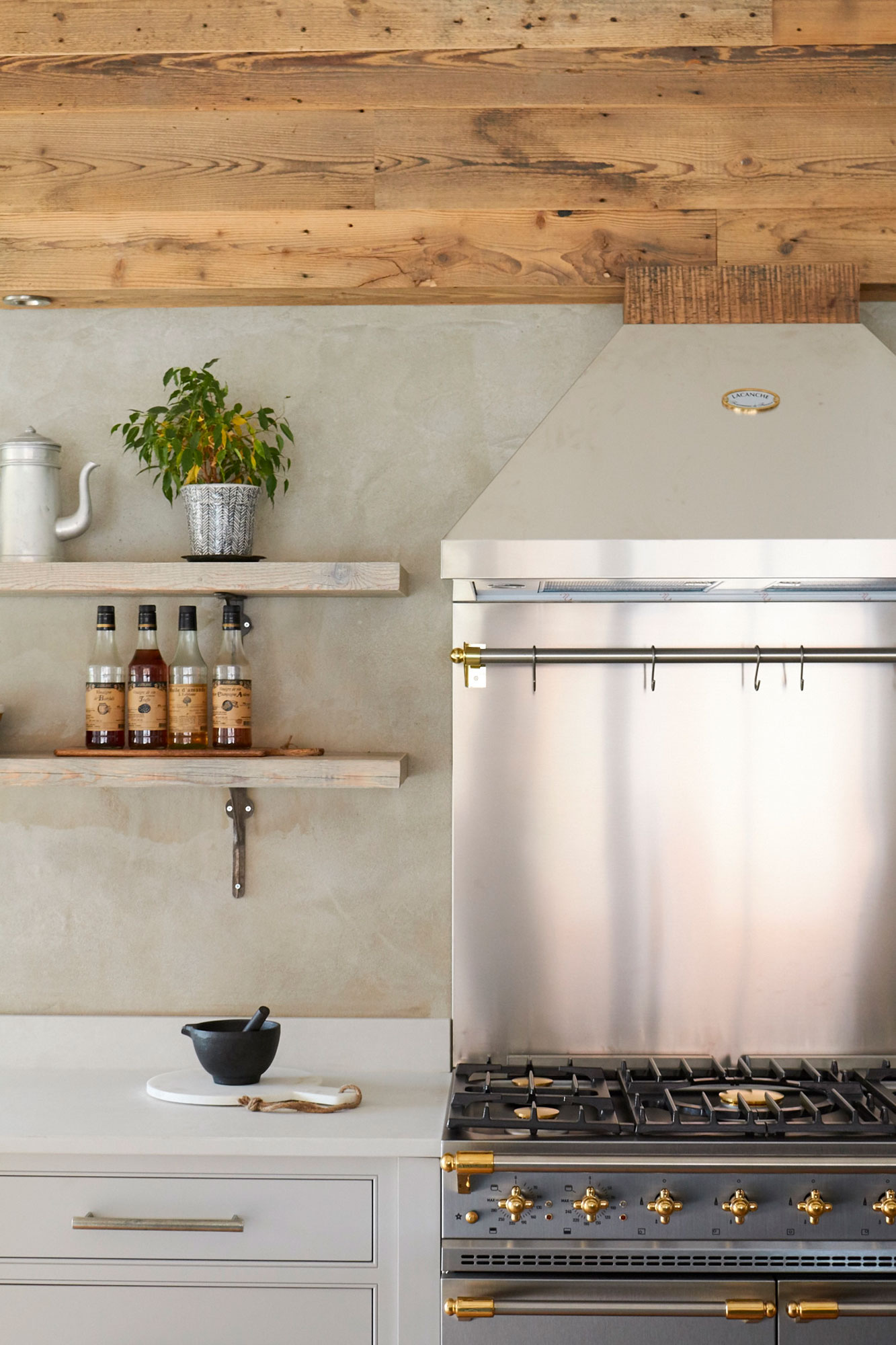 Lacanche brasserie stainless steel hood above gas range cooker