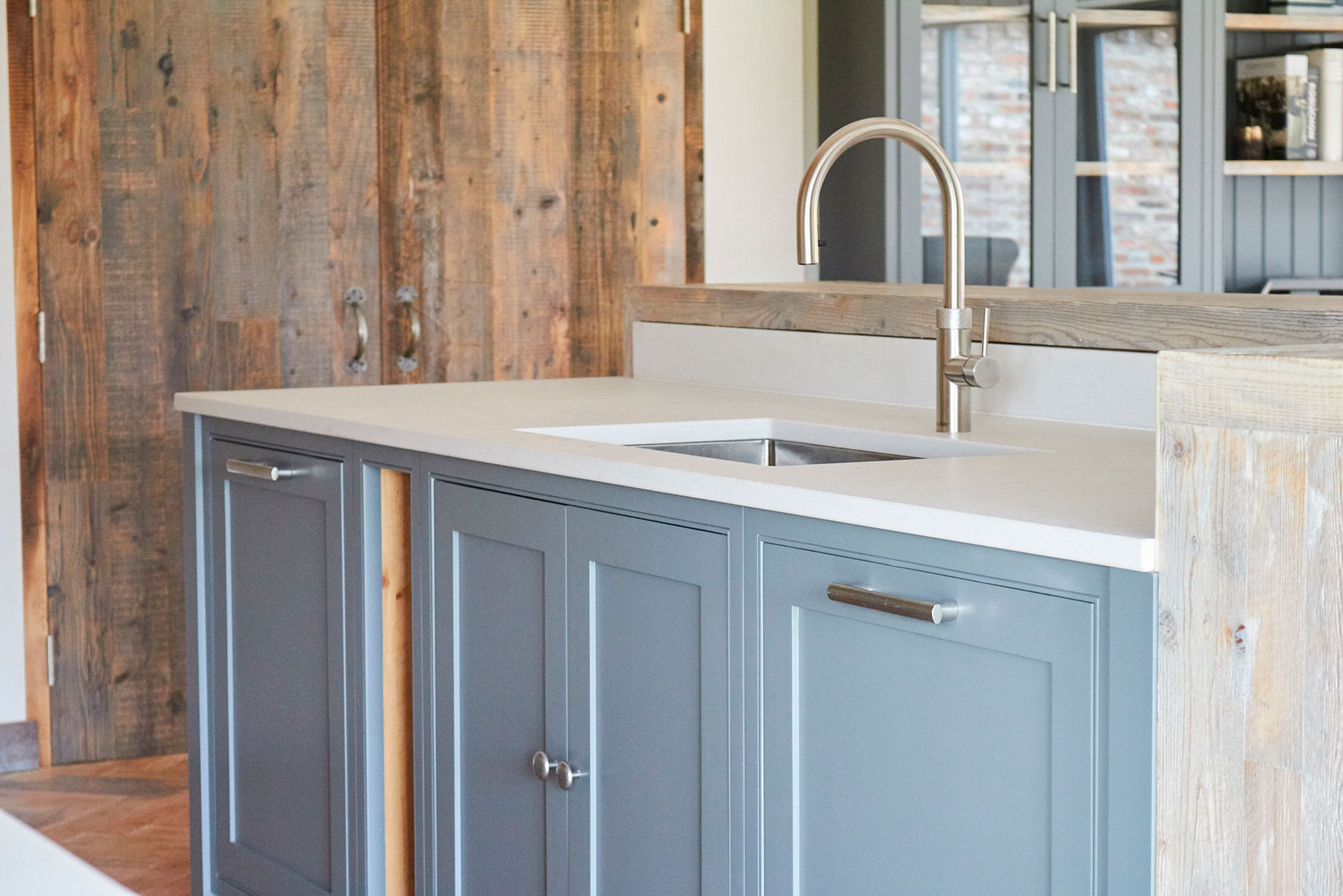 Painted kitchen cabinets with inset stainless steel sink and tap