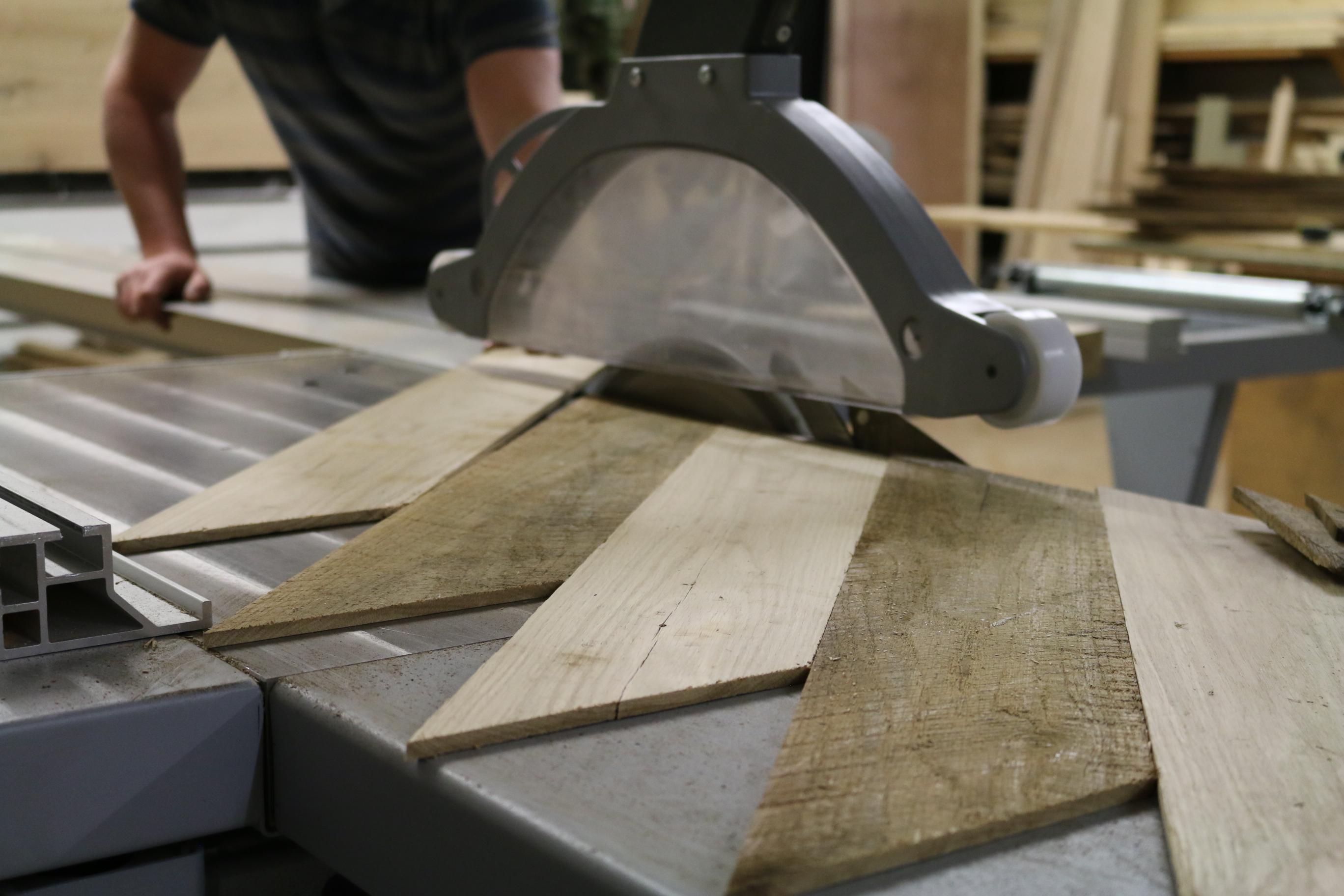 Worker on cross cut saw