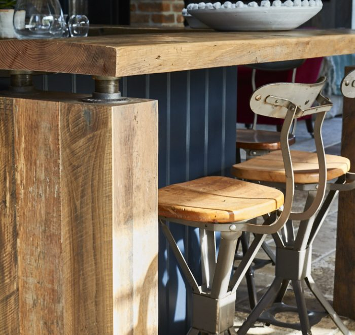 Chunky rustic breakfast bar with metal and wood barstool